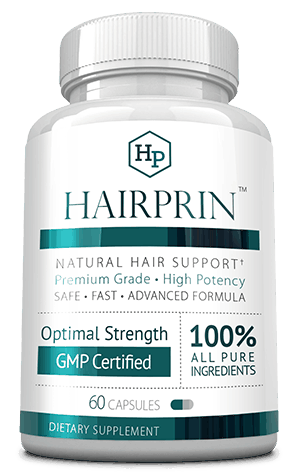 A bottle of hairprin - natural hair support supplement.